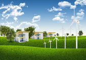 Blue sky, green grass and houses — Stock Photo