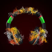Headphones in the colored smoke — Stock Photo