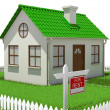 House on plot of grass with fence — Stockfoto