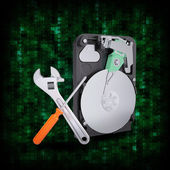 HDD with magnifying glass and adjustable wrench — Stock Photo