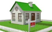 House on plot of grass with fence — Stock Photo