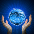 Hands hold glowing Earth. Hi-tech background — Stock Photo