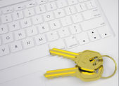 Two gold keys on the keyboard — Stock Photo
