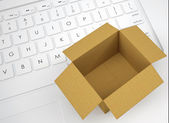 Open cardboard box on the keyboard — Stock Photo