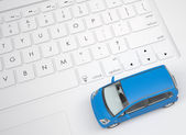 Small car on keyboard — Stock Photo