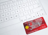 Shopping trolley and credit card — Stock Photo