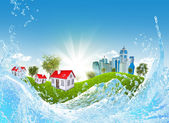Green grass, buildings and water — Stock Photo