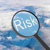 Magnifying glass looking Risk — Stock Photo