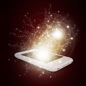Smart phone with magic light and falling stars — Stock Photo