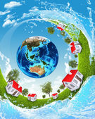 Earth, green grass, houses and water — Stock Photo