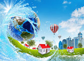 Earth, green grass, buildings and water — Stock Photo