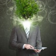 Businessman hold tablet pc. Green tree instead his head — Stock Photo #50375599
