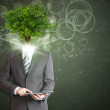 Businessman hold tablet pc. Green tree instead his head — Stock Photo #50375657