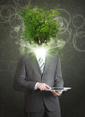 Businessman hold tablet pc. Green tree instead his head — Stock Photo