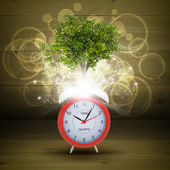Alarm clock with magical green tree — Stock Photo
