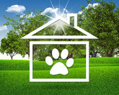 House icon with footprint of an animal — Stock Photo