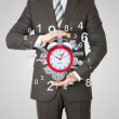 Businessman hold alarm clock — Stock Photo #50675273