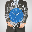 Businessman hold clock — Stock Photo #50675313