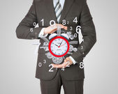 Businessman hold alarm clock — Stok fotoğraf