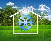 Kar sembolü ile ev simgesi — Stok fotoğraf