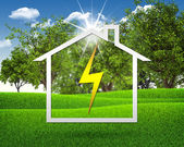 Symbol of electricity and house — Stock Photo