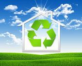 House icon with symbol recycling — Stockfoto