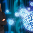 Businesswoman in a suit. Spheres of glowing digits — Stock Photo #51119225