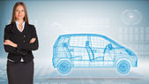 Businessman with wire frame car — Stock Photo