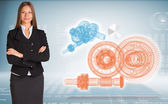 Businesswoman with wire frame gears — Stock Photo