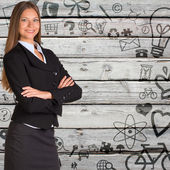 Businesswoman with background of various icons — Stock Photo