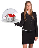 Businesswoman hold plate with small house — Foto de Stock