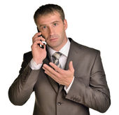 Close up of a laughing businessman on the phone — Stock Photo