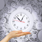Hand hold clock with gears — Stock Photo