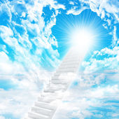 Stairs in sky with clouds and sun — Stock Photo
