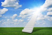 Stairs in sky with green grass, clouds and sun — Stock Photo