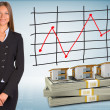 Businesswoman with houses and money — Stock Photo