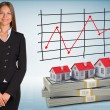 Businesswoman with houses and money — Stock Photo #51286545
