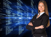 Businesswoman with background of digital code — Stock Photo