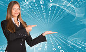Businesswomen pointing to empty copy space — Stock Photo