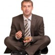 Businessman sitting and hold gold lamp — Stock Photo #51464629