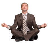 Businessman sitting in lotus position — Stock Photo