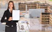 Businesswoman holding paper holder — Stock Photo