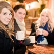 Foto Stock: Young drinking Punch at Christmas Market