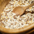 Muesli in a wooden Bowl - Stock Photo