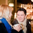 Couple on a Christmas Market - Stock Photo
