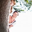 Two Woman behind a Tree — Stock Photo