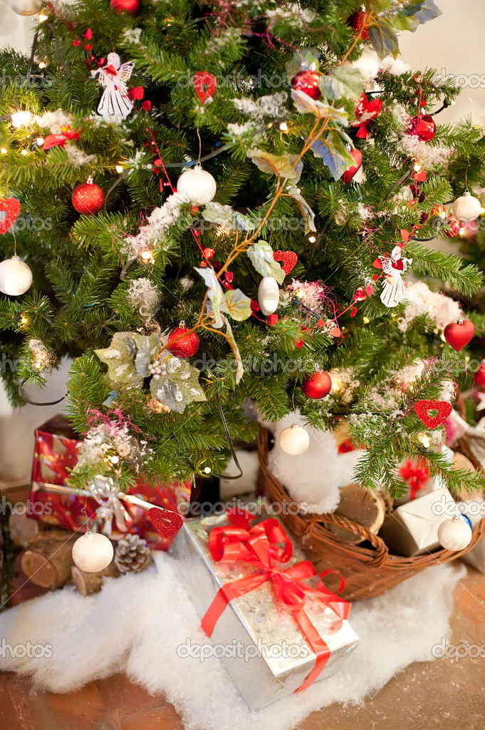 Rural Christmas Tree with some Presents under it — Stock Photo #16164267
