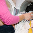 Woman filling Washing Machine — Stock Photo