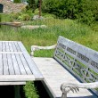 Wooden Bench in a Garden — Stockfoto