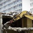 图库照片: Demolishing House